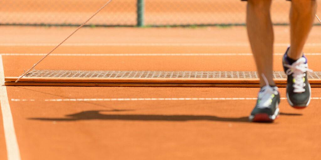 Tennis court grooming